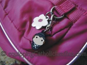 tiny saints pink purse pull