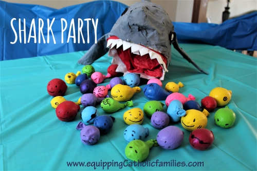paper mache shark with rice-filled-balloon fishies
